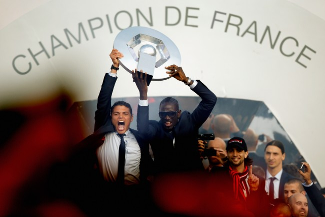 MAY 13: Captain, Thiago Silva (L) and Mamadou Sakho (R) of PSG celebrate in front of the fans after winning Ligue 1 during the Paris Saint-Germain Trophy Ceremony at Trocadero plaza on May 13, 2013 in Paris, France. (Photo by Dean Mouhtaropoulos/Getty Images)