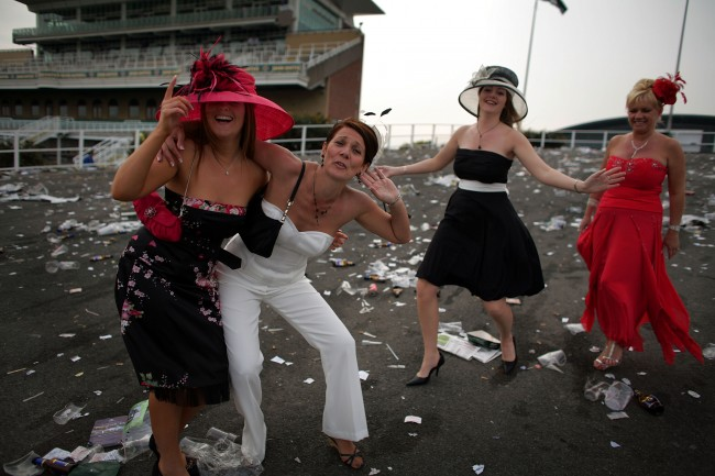 : Ladies make their way home at the end of Ladies Day on the second day of the Grand National meeting at Aintree Racecourse on 13 April 2007, Liverpool, England. Friday is traditionally Ladies day at the three-daymeeting of the world famous Grand National which takes place on saturday over a course of four miles and four furlongs (Photo by Christopher Furlong/Getty Images)