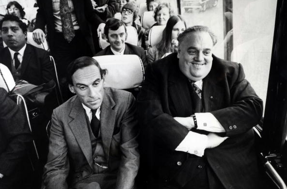 November 1972, Rochdale, Cyril Smith,  Liberal Democrat politician,having just been elected as a Liberal MP, sits on the Liberal bus next to party leader Jeremy Thorpe