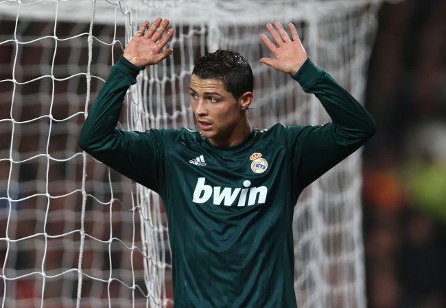Cristiano Ronaldo of Real Madrid reacts after scoring his team's second goal during the UEFA Champions League Round of 16 Second leg match between Manchester United and Real Madrid at Old Trafford on March 5, 2013 in Manchester, United Kingdom.  (Photo by Jasper Juinen/Getty Images)