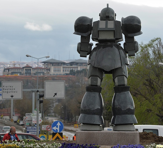 A view of the 'Transformers-esque' statue near Turkeys new presidential palace in Ankara, erected by the city Mayor Melih Gokcek, seen on April 2, 2015. The people of the Turkish capital believed it an April Fools joke, but no, it was real: The controversial mayor of Ankara has erected in the center of the megacity a giant statue made of metal and polyester that looks suspiciously like a production robot American 'Transformers'. The statue is expected to promote a giant amusement park, the Anka Park, which is under construction despite a court order which has found it in part to be contrary to the town planning rules.