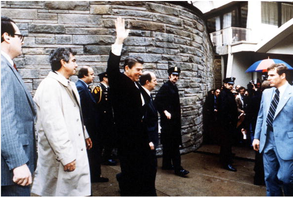 resident Ronald Reagan Waves To Onlookers Moments Before An Assassination Attempt By John Hinckley Jr March 30, 1981 By The Washington Hilton In Washington Dc.James Brady Is Visible Third From The Left.