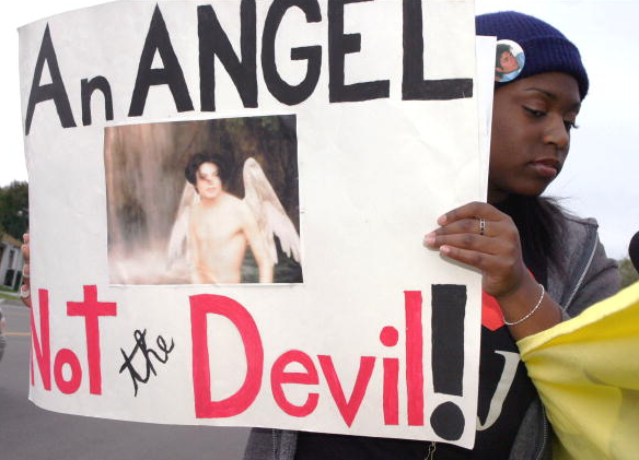 Michael Jackson supporter, Olivia Baker, 20, of San Diego, holds a sign outside the courthouse at Michael Jackson's preliminary hearing on February 13, 2004 in Santa Barbara, California.