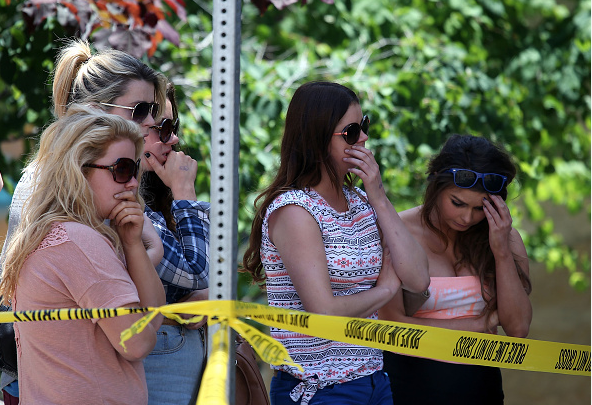 JUNE 16: People look on at the scene of a balcony collapse at an apartment building near UC Berkeley on June 16, 2015 in Berkeley, California. 6 people were killed and 7 were seriously injured when a balcony collapsed at an apartment building near the University of California at Berkeley campus. (Photo by Justin Sullivan/Getty Images)