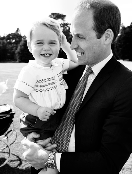 KING'S LYNN, ENGLAND - JULY 05: (EDITORIAL USE ONLY)  In this handout image supplied by Mario Testino/ Art Partner, Prince William, Duke of Cambridge and his son Prince George of Cambridge pose for a photo after the christening of Princess Charlotte of Cambridge at the Sandringham Estate on July 5, 2015 in King's Lynn, England. (Photo by Mario Testino/ Art Partner via Getty Images)  ***Terms of release, which must be included and passed-on to anyone to whom this image is supplied: USE AFTER 10/10/2015 must be cleared by Art Partner. This photograph is for editorial use only. NO commercial use. NO use in calendars, books or supplements. Use on a cover, or for any other purpose, will require approval from Art Partner and the Kensington Palace Press Office. There is no charge for the supply, release or publication of this official photograph. This photograph must not be digitally enhanced, manipulated or modified and must be used substantially uncropped. Picture must be credited: copyright Mario Testino /Art Partner***