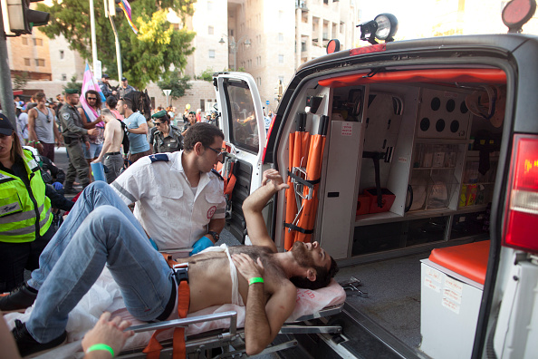 JERUSALEM, ISRAEL - JULY 30:  A wounded Israeli person receives treatment during the gay parade on July 30, 2015 in Jerusalem, Israel. At least six people were stabbed at Jerusalem's annual Gay Pride Parade on Thursday. The assailant, an ultra-Orthodox Jew, emerged behind the marchers and began stabbing them while screaming. A police officer then managed to tackle him to the ground and arrest him.  (Photo by Lior Mizrahi/Getty Images)