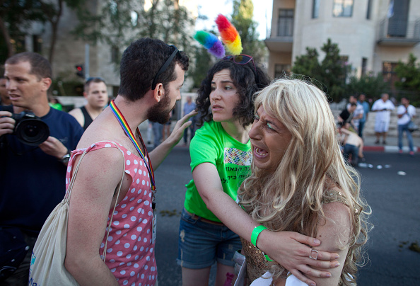 JERUSALEM, ISRAEL - JULY 30:  An Israeli cries after a stabbing during the Gay Pride Parade on July 30, 2015 in Jerusalem, Israel. At least six people were stabbed at Jerusalem's annual Gay Pride Parade on Thursday. The assailant, an ultra-Orthodox Jew, emerged behind the marchers and began stabbing them while screaming. A police officer then managed to tackle him to the ground and arrest him.  (Photo by Lior Mizrahi/Getty Images)