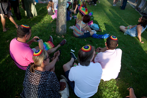 JERUSALEM, ISRAEL - JULY 30:  Israelis wearing Jewish Skull Caps participate in the Gay Pride Parade on July 30, 2015 in Jerusalem, Israel. At least six people were stabbed at Jerusalem's annual Gay Pride Parade on Thursday. The assailant, an ultra-Orthodox Jew, emerged behind the marchers and began stabbing them while screaming. A police officer then managed to tackle him to the ground and arrest him.  (Photo by Lior Mizrahi/Getty Images)