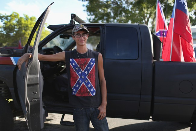 LOXAHATCHEE, FL - JULY 11:  Max Hechinger displays a Confederate flag on his shirt as he participates in a rally to show support for the American and Confederate flags on July 11, 2015 in Loxahatchee, Florida. Organizers of the rally said that after the Confederate flag was removed from South Carolinas State House it reinforced their need to show support for the Confederate flag which some feel is under attack.  (Photo by Joe Raedle/Getty Images)