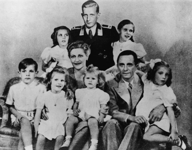 German Nazi politician and minister of propaganda Paul Joseph Goebbels (1897 - 1945) with his wife Magda and their children, Helga, Hildegard, Helmut, Hedwig, Holdine and Heidrun, 1942. Also present is Harald Quandt (in uniform), Magda Goebbels' son by her first marriage. With the fall of the Third Reich, Magda and Josef Goebbels poisoned their six children before themselves committing suicide. (Photo by Keystone/Hulton Archive/Getty Images)