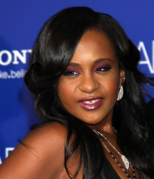 "Bobbi Kristina Brown Has Diedwo months transferred to a rehabilitation centre.  One month ago she was moved into a hospice.  D-listed notes:  The D.A. has reportedly been investigating Bobbi Kristina's adopted brother/fake husband Nick Gordon, because they believe he may have had something to do with why she lost consciousness. Bobbi Kristina's conservator has also thrown a lawsuit at Nick for allegedly stealing her money, abusing her and pretending to be her husband.  Her family have released a statement:  ""She is finally at peace in the arms of God. We want to again thank everyone for their tremendous amount of love and support during these last few months.""  Her mother's Facebook page made a anouncment:"