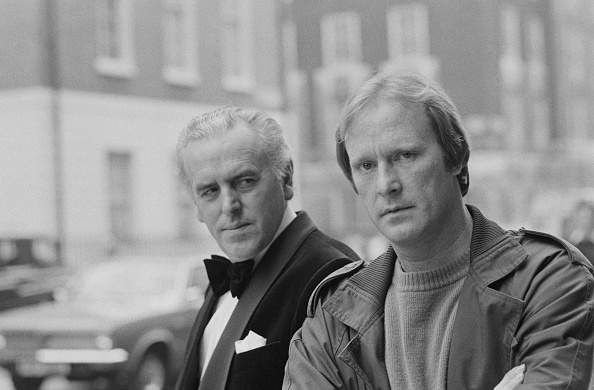 English actors George Cole (left) and Dennis Waterman pictured together in character as Arthur Daley and Terry McCann during filming of the television series Minder in London on 3rd October 1979. (Photo by United News/Popperfoto/Getty Images)