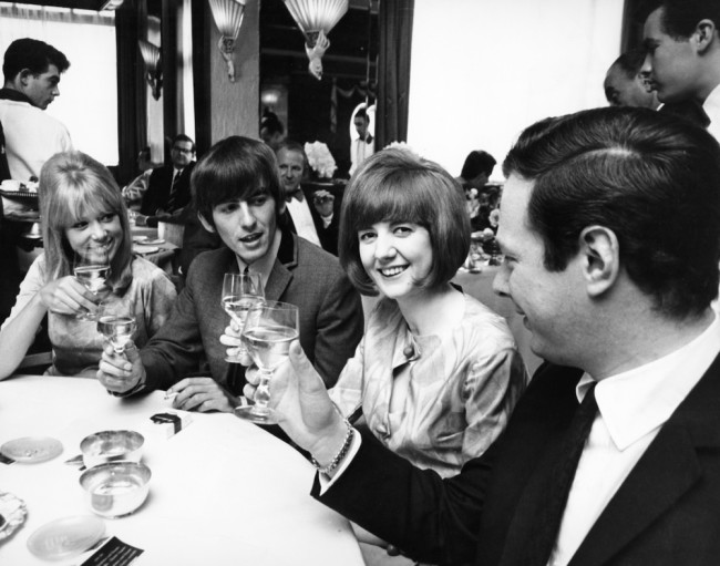 Pop star George Harrison of The Beatles, Beatle manager Brian Epstein, singer Cilla Black and her friend Patti Boyd, on May 28, 1964.  (Photo by Daily Express/Archive Photos/Getty Images)
