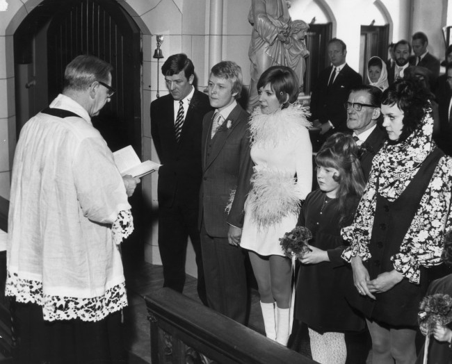 January 1969:  Pop singer and TV star Cilla Black with her manager and husband at their second marriage ceremony , the first was in Marylebone Registry office in London and this one is in the Catholic church of St Mary's in Liverpool.  (Photo by Keystone Features/Getty Images)