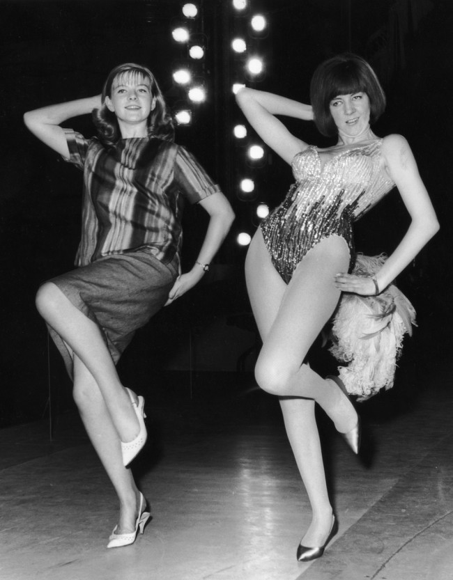 21st July 1964:  Fifteen year old Beverley Hadden teaching Cilla Black a dance routine for her performance in the charity gala 'Night of 100 Stars' at the London Palladium.  (Photo by Central Press/Getty Images)