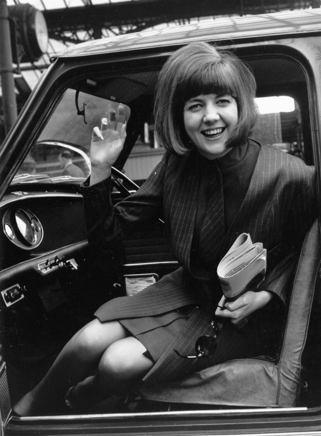 25th May 1964:  Pop singer Cilla Black in her mini.  (Photo by Sydney O'Meara/Evening Standard/Getty Images)