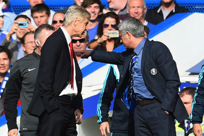 LONDON, ENGLAND - OCTOBER 05:  Managers Arsene Wenger of Arsenal and Jose Mourinho manager of Chelsea clash during the Barclays Premier League match between Chelsea and Arsenal at Stamford Bridge on October 4, 2014 in London, England.  (Photo by Shaun Botterill/Getty Images)