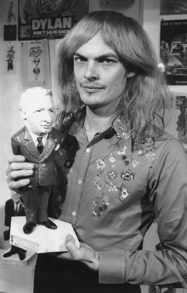 Artist Alan Aldridge with a model of Conservative leader Edward Heath used in posters for the Labour Party's 1970 election campaign under the slogan 'Yesterday's Men V Tomorrow's Winning Team', 12th May 1970. (Photo by Keystone/Hulton Archive/Getty Images)