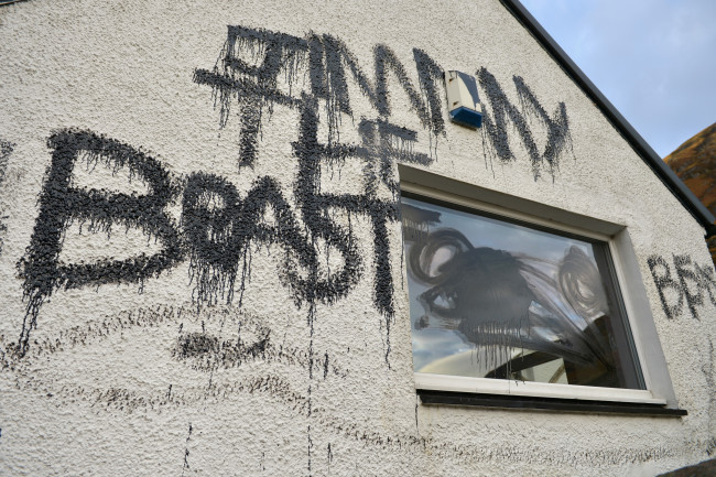 GLEN COE, UNITED KINGDOM - OCTOBER 29:  Slogans painted on Alt-na-reigh, the cottage owned by Jimmy Savile, which police searched last week as investigations continue on October 29, 2012 in Glen Coe, Scotland. The cottage is situated next to the A82 road that runs from Fort William to Glasgow and was vandalised over the weekend after police searched it last week as part of the UK wide investigation into alleged child abuse by the former television presenter.  (Photo by Jeff J Mitchell/Getty Images)