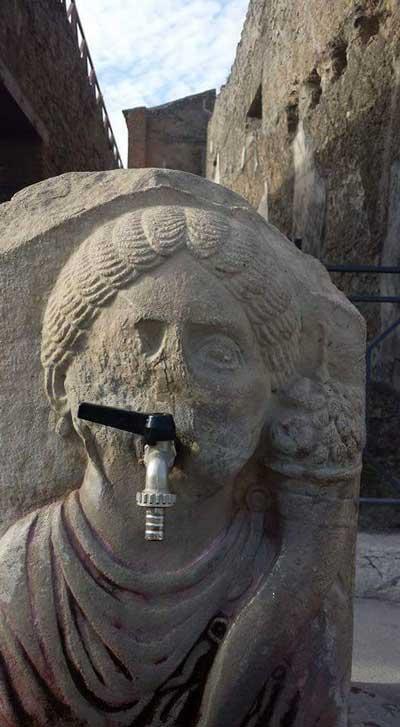 tap face statue