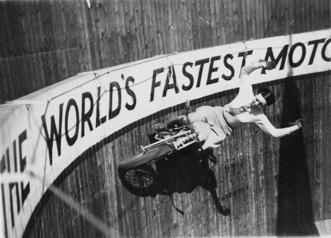 Marjorie Dare (Doris Smith) riding with around 'The Wall of Death' sideshow at the Kursaal amusement park in Southend, Essex, 1938. (Photo by Fox Photos/Hulton Archive/Getty Images)