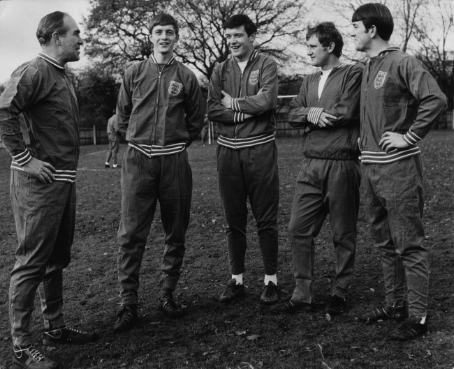 10th December 1968: England manager Sir Alf Ramsey talks with three of the English soccer team training at the Bank of England Sports Ground, Roehampton as they prepare for a match against Bulgaria. L to r, Sir Alf Ramsey, Alan Clarke (Arsenal), Cyril Knowles, Len Badger and Howard Kendall. (Photo by Jim Gray/Keystone/Getty Images)