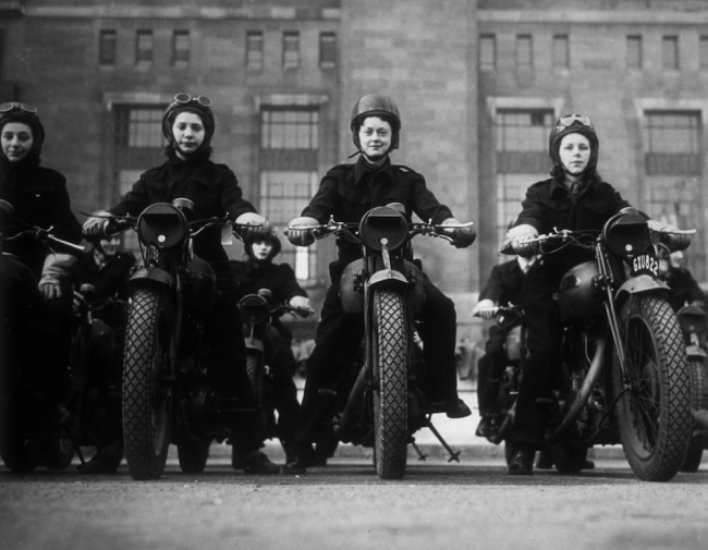 circa 1940:  Ministry of Information dispatch riders on their motorbikes.  (Photo by Fox Photos/Getty Images)