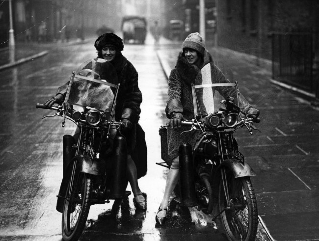 23rd September 1925:  The Debenham sisters wearing fur and waterproof clothing for the winter motorcyclist. The women are riding BSA cycles.  (Photo by H. F. Davis/Topical Press Agency/Getty Images)