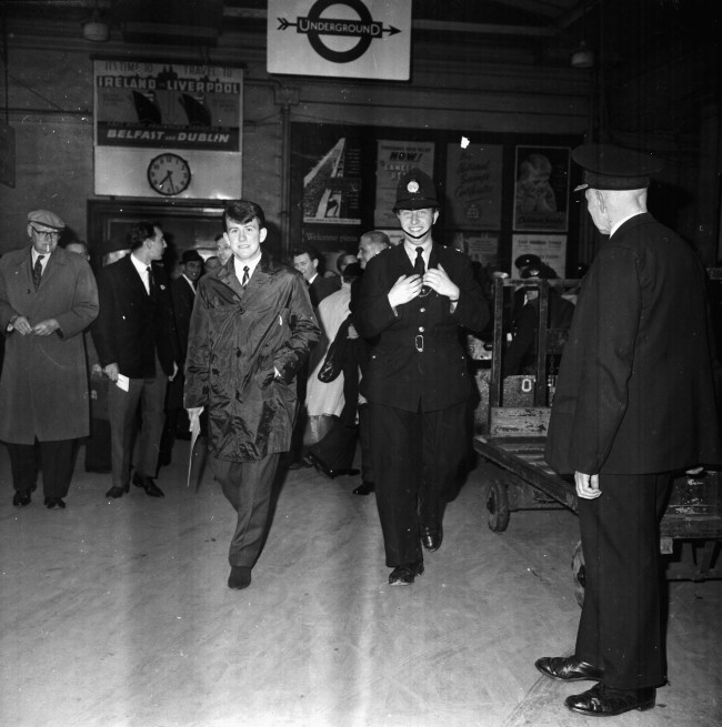 Preston Football Club's Howard Kendall, being escorted through a train station, in the city for his teams match at Wembley Stadium, London, April 1964. (Photo by Kaye/Express/Getty Images)