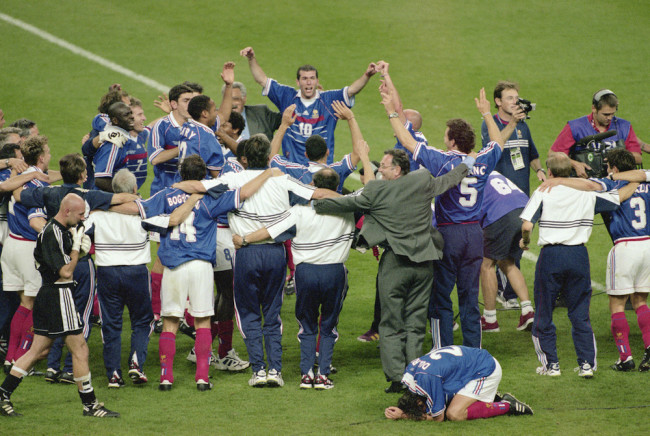 12 Jul 1998: Zinedine Zidane (no.10) of France is hailed by his team mates after a match winning performance in the World Cup Final against Brazil at the Stade de France in St Denis. Zidane scored twice as France won 3-0. Mandatory Credit: Stu Forster/Allsport