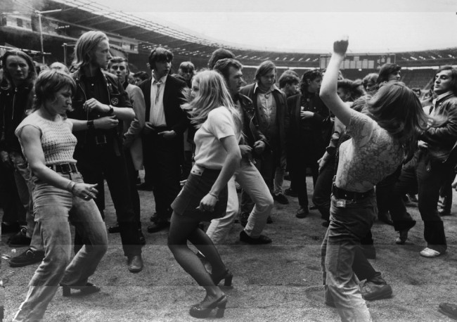 5th August 1972: Three women dancing together during a rock 'n' roll festival at Wembley Stadium. (Photo by Central Press/Getty Images)