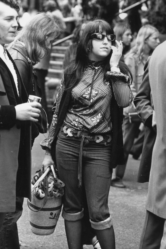 1972: A woman standing next to a teddy-boy sells leather belts at the Rock n' Roll Festival, Wembley Stadium. (Photo by Evening Standard/Getty Images)