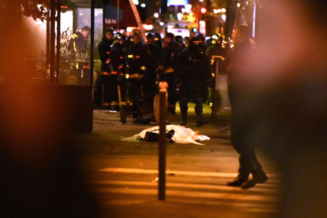 PARIS, FRANCE - NOVEMBER 13: (EDITORS NOTE: Image contains graphic content.) Remains are seen outside the Bataclan concert hall after an attack on November 13, 2015 in Paris, France. According to reports, over 150 people were killed in a series of bombings and shootings across Paris, including at a soccer game at the Stade de France and a concert at the Bataclan theater. (Photo by Thierry Orban/Getty Images) (Photo by Pascal Le Segretain/Getty Images)