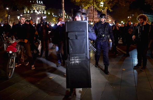 Armed police are deployed in Place de la Republique during a false alarm incident on November 15, 2015 in Paris, France. France is currently observing three days of national mourning members of the public continue to pay tribute to the victims of Friday's deadly attacks. A special service for the families of the victims and survivors is to be held at Paris's Notre Dame Cathedral. (Photo by Jeff J Mitchell/Getty Images)