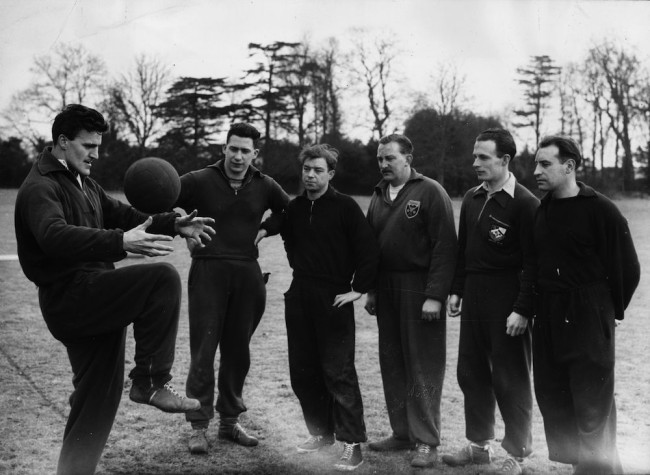 3rd March 1956: Senior F.A. (Football Association) coach Jimmy Hill (left) giving a coaching lesson to (from left) Charles Stewart, Douglas Bristow, Bill Chivers, Don Palmer and Don Haskow at Bisham Abbey, Buckinghamshire. (Photo by G. R. Greated/Fox Photos/Getty Images)