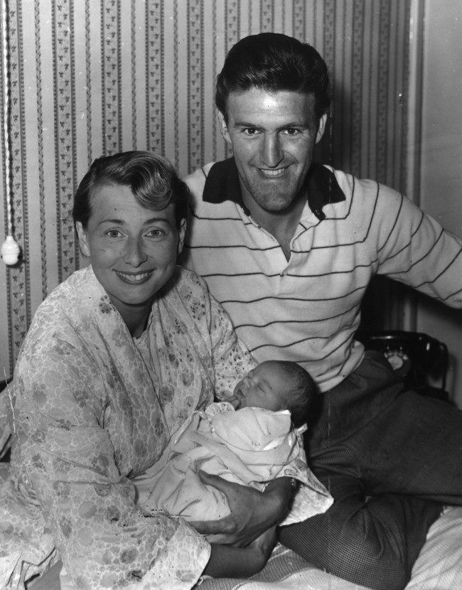4th August 1959: Fulham footballer Jimmy Hill and his wife Gloria with their baby son, as yet unnamed. He was born at the couple's Worcester Park home. (Photo by Evening Standard/Getty Images)