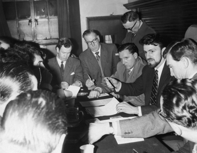 10th January 1961: Jimmy Hill, President of the Professional Footballers' Association, talks to members of the press at St Pancras Town Hall, London. The topic in question is the threatened football players' strike. (Photo by Douglas Miller/Keystone/Getty Images)