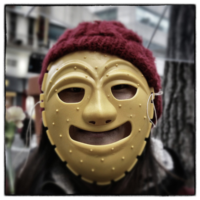 SEOUL, SOUTH KOREA - DECEMBER 05: (EDITORS NOTE: Image was altered with digital filters.) A protester wearing a mask during the anti-government rally on December 5, 2015 in Seoul, South Korea. Demonstrators gathered on the streets of Seoul to protest against the government's decision to adopt new history textbooks and reform the labor market. Liberal civic groups decided to proceed the protest in the central Seoul despite a prohibition order from the police. (Photo by Chung Sung-Jun/Getty Images)
