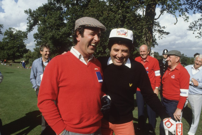 1981:  Irish television and radio presenter, Terry Wogan, with the Liverpudlian comedian, Jimmy Tarbuck, during the Bob Hope British Classic golf tournament at Moor Park golf course.  (Photo by Hulton Archive/Getty Images)