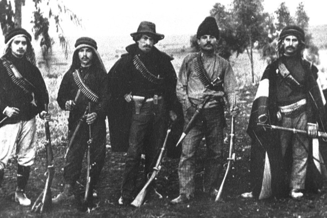 UPPER GALILEE, OTTOMAN PALESTINE - OCTOBER 1, 1907: Members of Hashomer, a Jewish security organization dedicated to protecting pioneering Zionist settlements, pose with their rifles October 1, 1907 in the Upper Galilee during the Ottoman rule of Palestine in what would later become the State of Israel. (Photo by GPO via Getty Images)