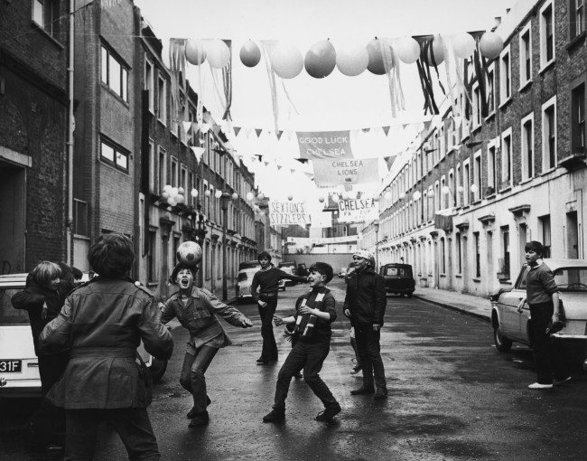 A group of boys celebrate the upcoming FA Cup Final between Leeds United and Chelsea at Wembley with a match of their own in Chelsea's Slaidburn Street, 10th April 1970. (Photo by Michael Webb/Keystone/Hulton Archive/Getty Images)