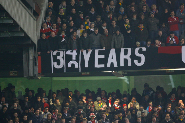 MANCHESTER, ENGLAND - JANUARY 27: Manchester United fans display a banner taunting Manchester City during the Carling Cup Semi Final second leg match between Manchester United and Manchester City at Old Trafford on January 27, 2010 in Manchester, England. (Photo by Alex Livesey/Getty Images)