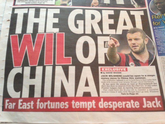 Transfer balls: Arsenal's Wilshere rides to China on a human caterpillar
