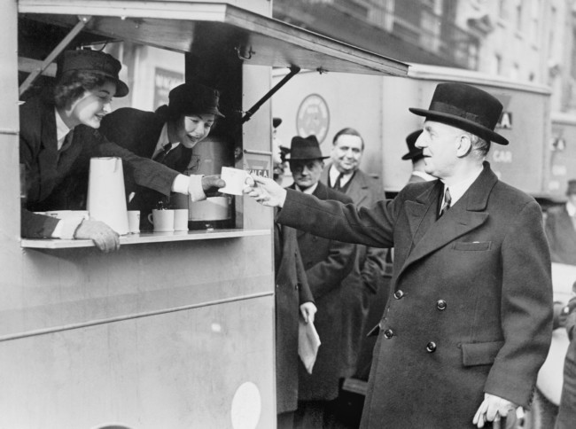 The British Minister for Food between April 1940 and 11 November 1943, Lord Woolton, receiving a cup of tea from a mobile canteen.