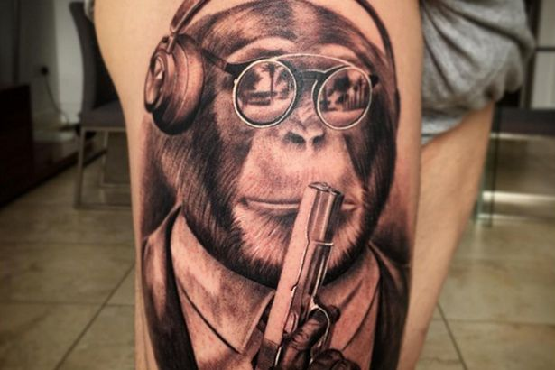 tattoo monkey gun