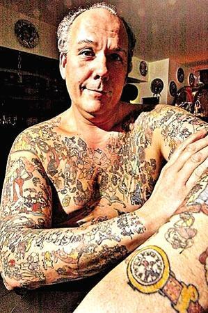56, of Bethlehem, Pennsylvania is erasing the 2200 Disney tattoos that