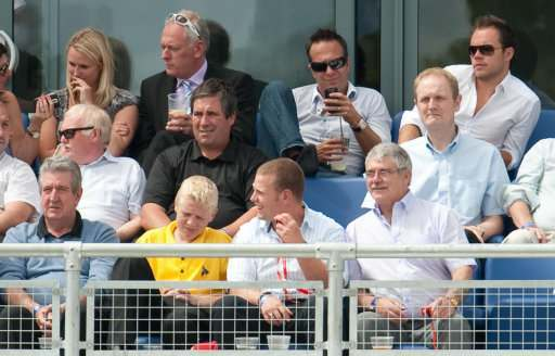 Former England captain Michael Vaughan watches the action from the stands during day one of the first npower Test match at Sophia Gardens, Cardiff.