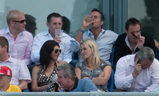 Former England captain Michael Vaughan watches during day one of the first npower Test match at Sophia Gardens, Cardiff.