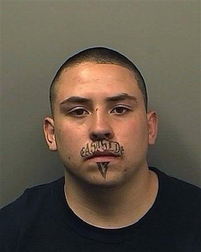 "That's him with ""East Side"" tattooed on his upper lip – and ""13"" tattooed on"