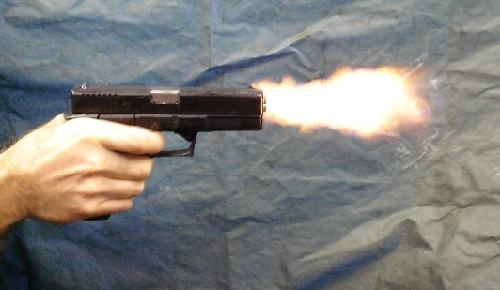 Handgun Firing Stock Photo